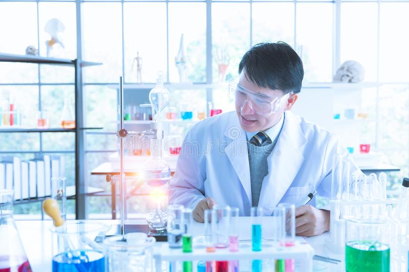 Scientist recording experiment result in lab room royalty free stock images