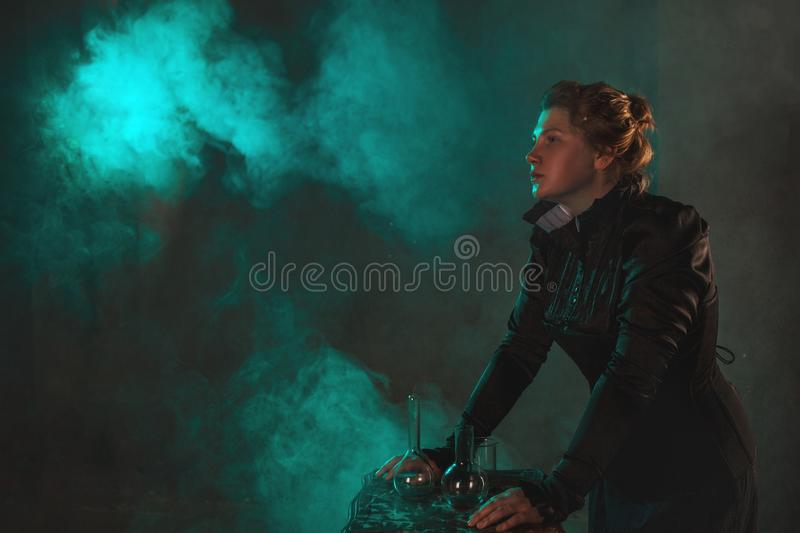 Scientist researcher on abstract background. History of science, great physical discoveries, structure of atom. Image in style of Marie Curie, concept royalty free stock image