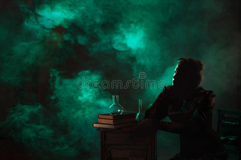 Scientist researcher on abstract background. History of science, great physical discoveries, structure of atom. Image in style of Marie Curie, concept royalty free stock images