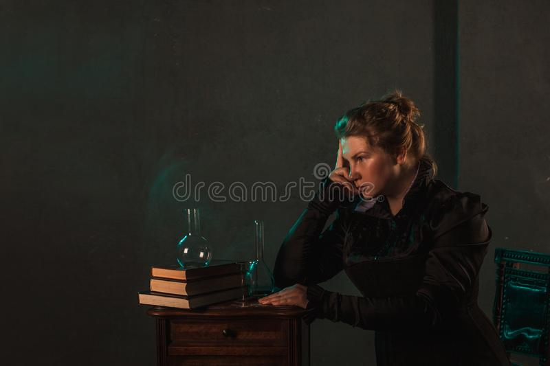 Scientist researcher on abstract background. History of science, great physical discoveries, structure of atom. Image in style of Marie Curie, concept stock photos