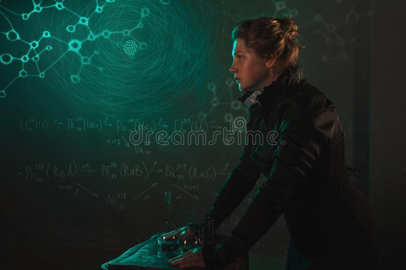 Scientist researcher on abstract background of schemes and formulas. History of science, great physical discoveries. Radioactivity and structure of atom. Image royalty free stock photos