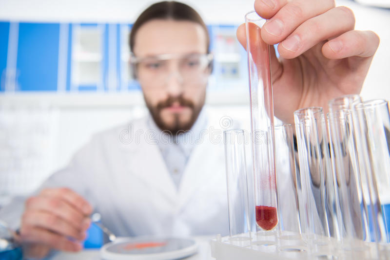 Scientist showing test tube stock photography
