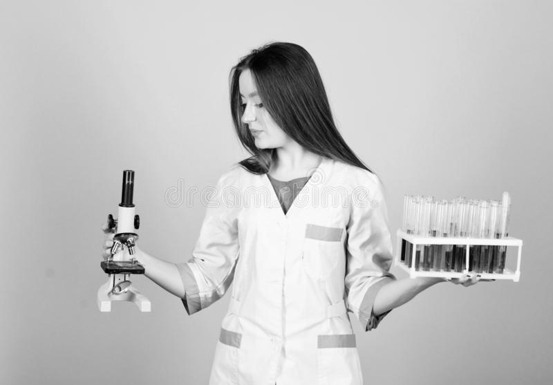 Scientist study science. girl scientist in lab. good result. girl doctor with testing tube microscope, research. Experimenting with chemicals or microscope at stock photos