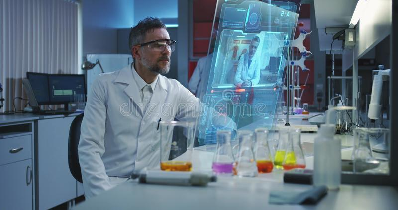 Scientist using a holographic display screen royalty free stock photos