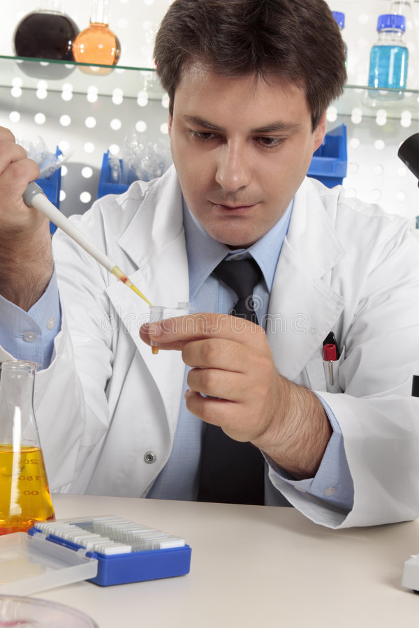 Scientist using pipette in lab royalty free stock photography