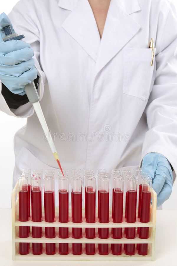Scientist using pipette to extract samples stock photos