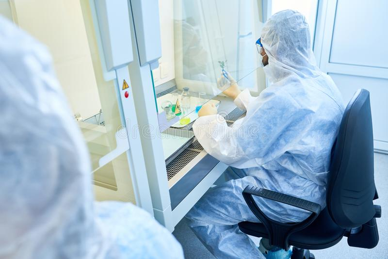 Scientist Working with Hazardous Substance stock photo