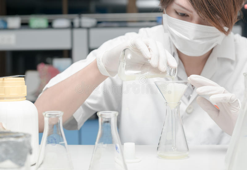 Scientist working in laboratory, testing samples stock photography