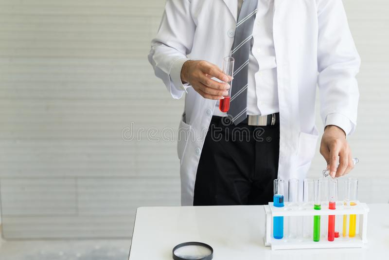 Scientists are doing experiments in the laboratory glass tube. stock photography