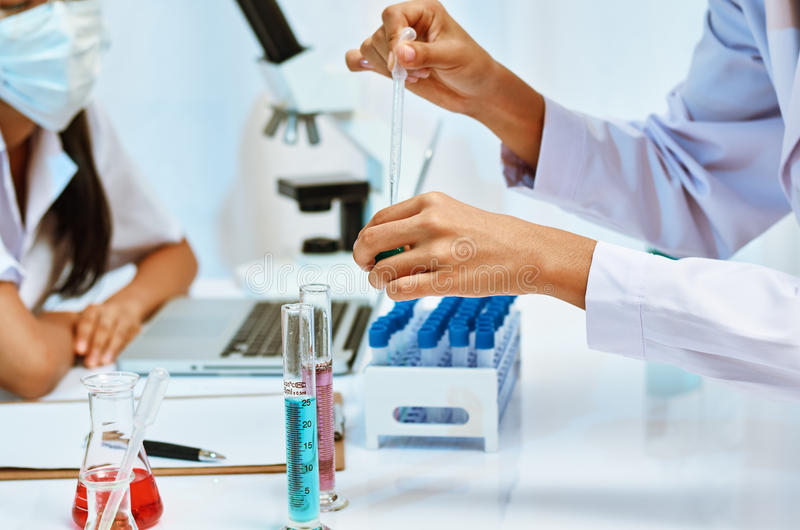 Scientists experimenting in laboratory royalty free stock photography