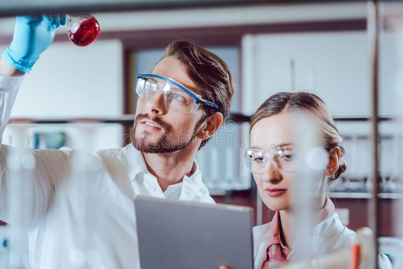 Scientists in the lab obtaining experimental data stock photo