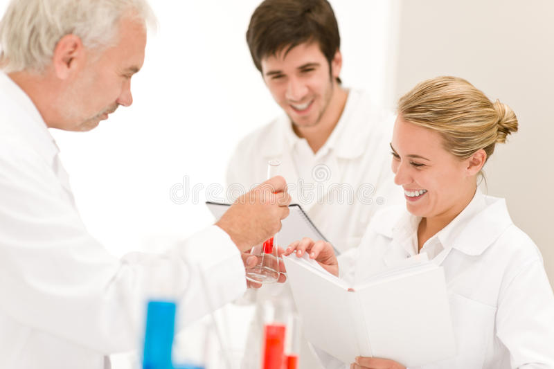 Scientists in laboratory - medical research. Team of scientists in laboratory - medical research, flu virus vaccination royalty free stock images