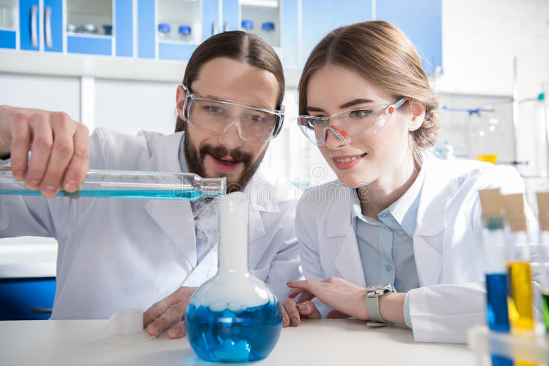 Scientists making experiment stock photography