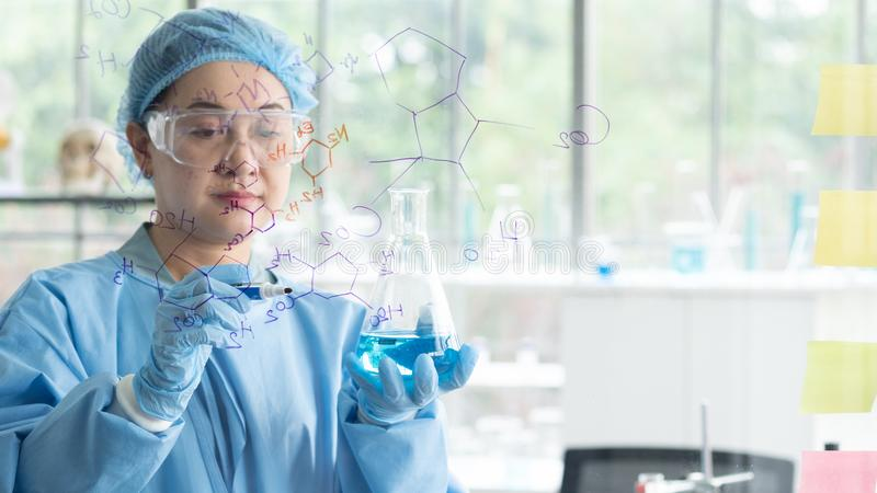 Scientists research and analyze chemical formulas. Scientists research, analyze chemical formulas, biological test results, Professor discovered a new formula stock images