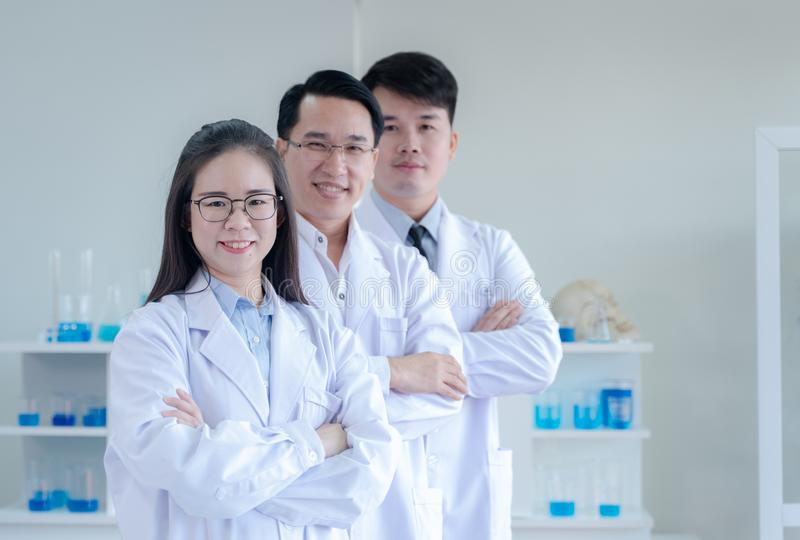 Scientists standing and crossing arms stock photos