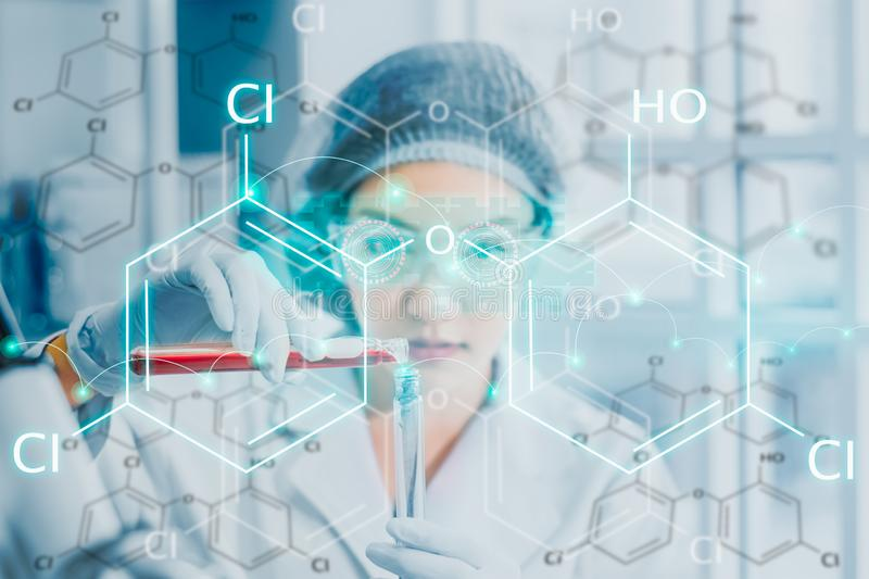 Scientists testing chemical ingredient,with icon and chemical symbol, test samples of antibiotics and future food used in medical. Development for people stock photography