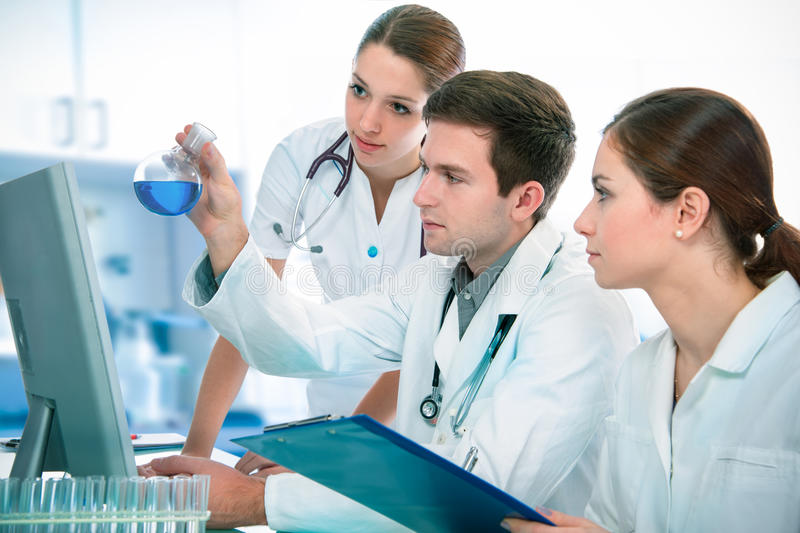 Scientists working at the laboratory stock photography