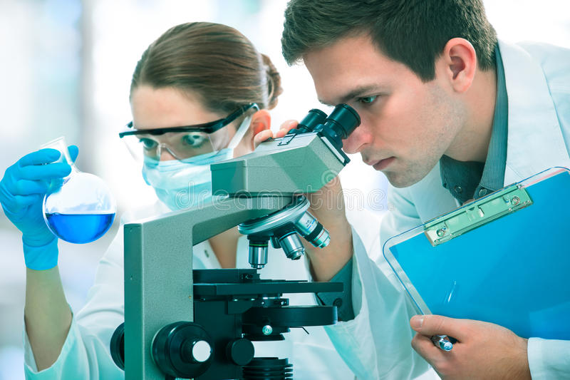 Scientists working at the laboratory stock photos