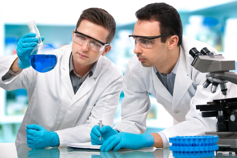Scientists working in a research laboratory stock photo