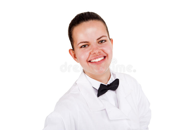 Scince-Frau im Laborkittel und Bogen tai, die über weißem backgrou lächeln lizenzfreie stockfotografie