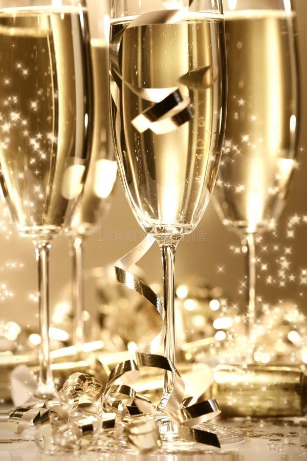 Scintilla dorata del champagne immagini stock