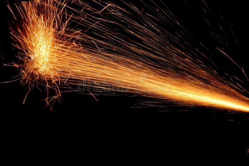 Scintille di fuoco sul nero immagini stock libere da diritti