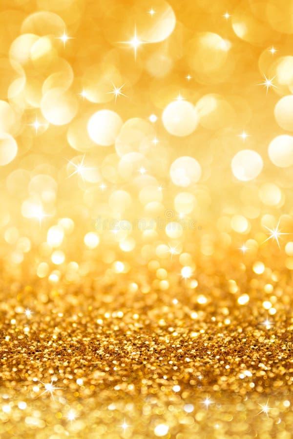 Scintillement d'or et étoiles pour le fond de Noël images libres de droits