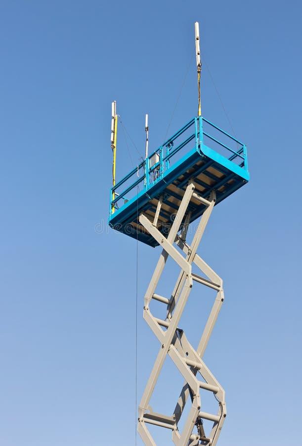 Scissor Lift. Is used at its maximum height range stock photos