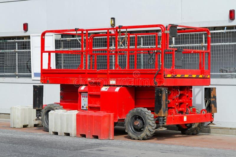 Scissor platform lift. Used on construction site stock images