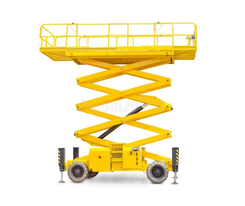 Scissor wheeled lift on a light background. Yellow scissor wheeled lift on a light background stock photos