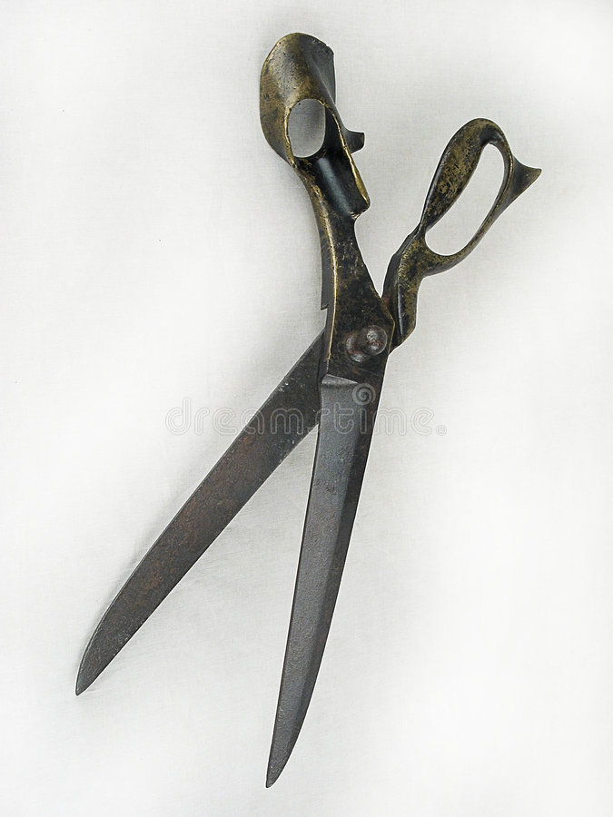 Scissors. Old metal scissors on a white background stock images