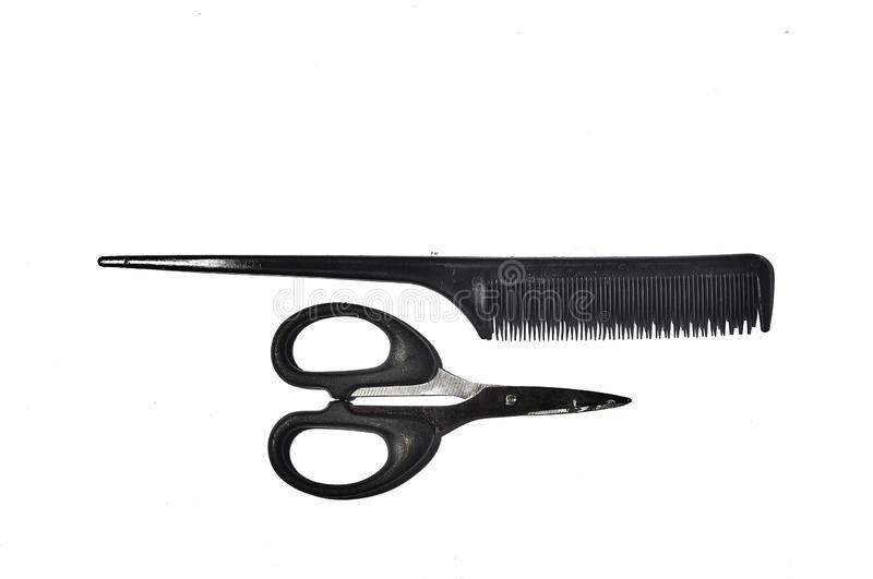 Scissors and black comb isolated on white background royalty free stock photo