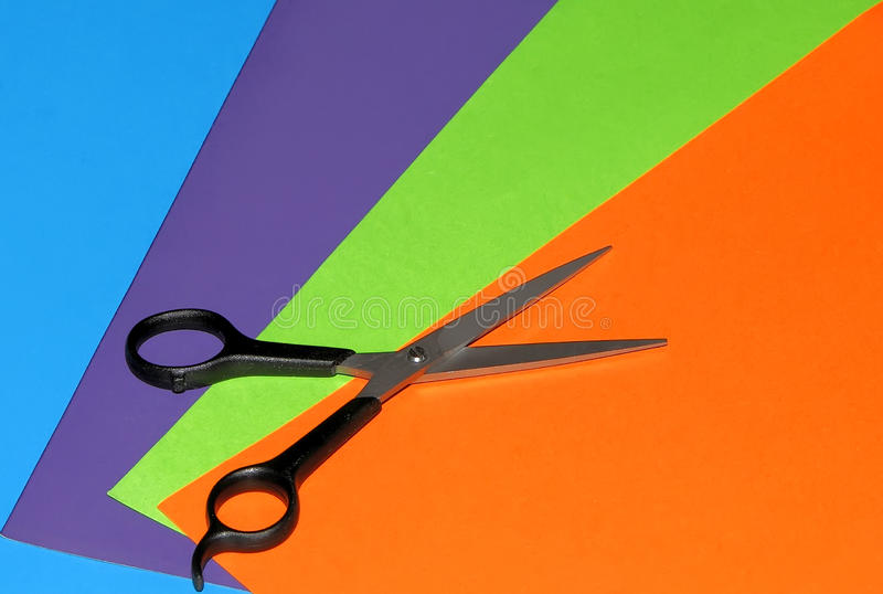 Scissors and color paper stock image