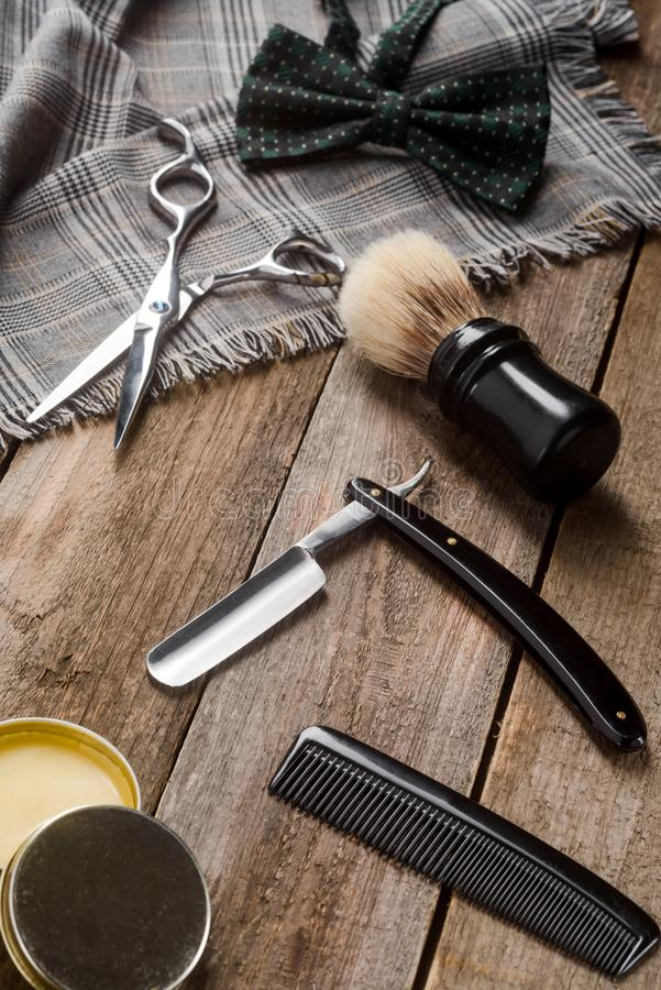 Scissors, comb and bow tie royalty free stock photography