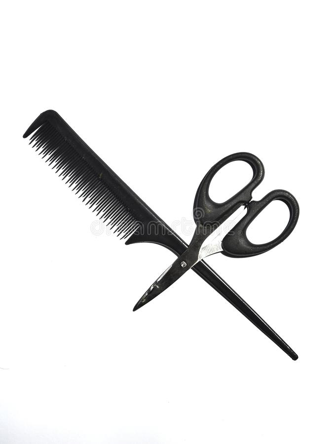 Scissors and comb isolated on white background stock image