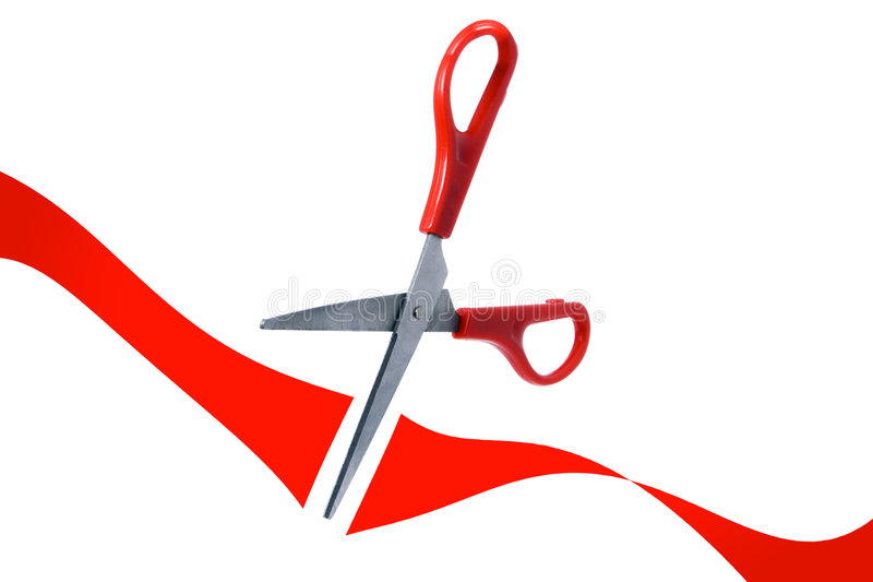 Scissors cut red ribbon in grand opening. On white background royalty free stock photos