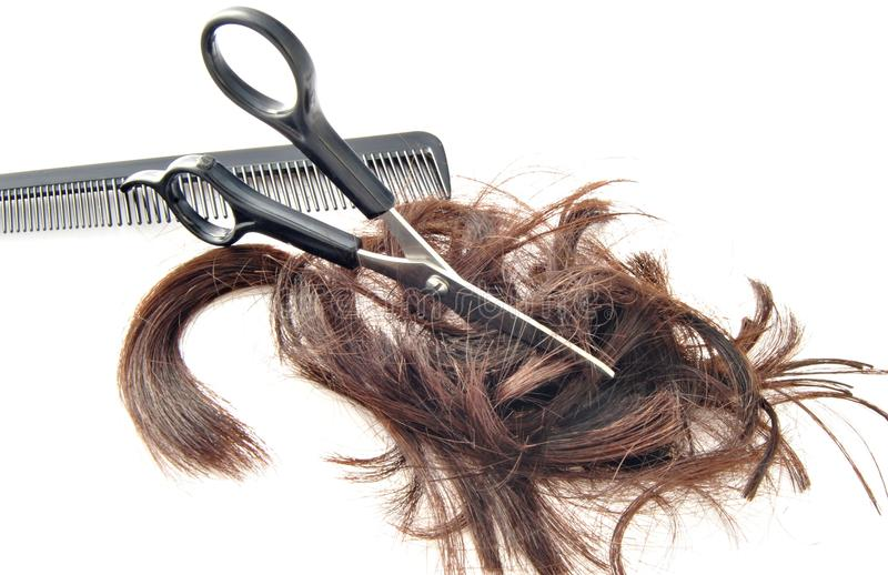 Scissors cutting hair stock images