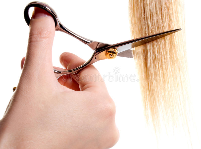 Scissors cutting lock of hair stock photo