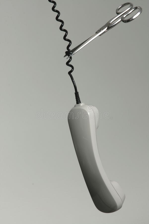 Scissors cutting telephone cable