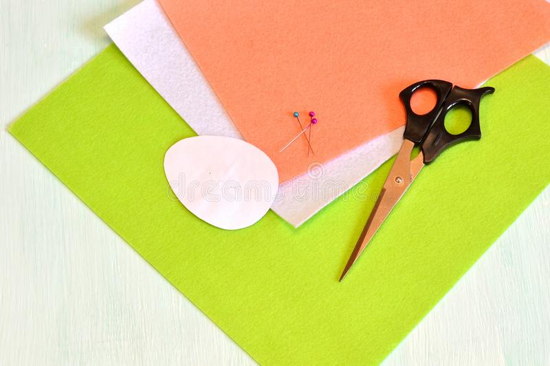 Scissors, felt, pins, paper templates - sewing set Easter egg. Sewing. Step royalty free stock image