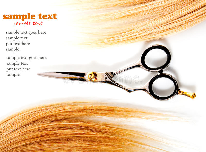 Scissors and lock of hair royalty free stock photo