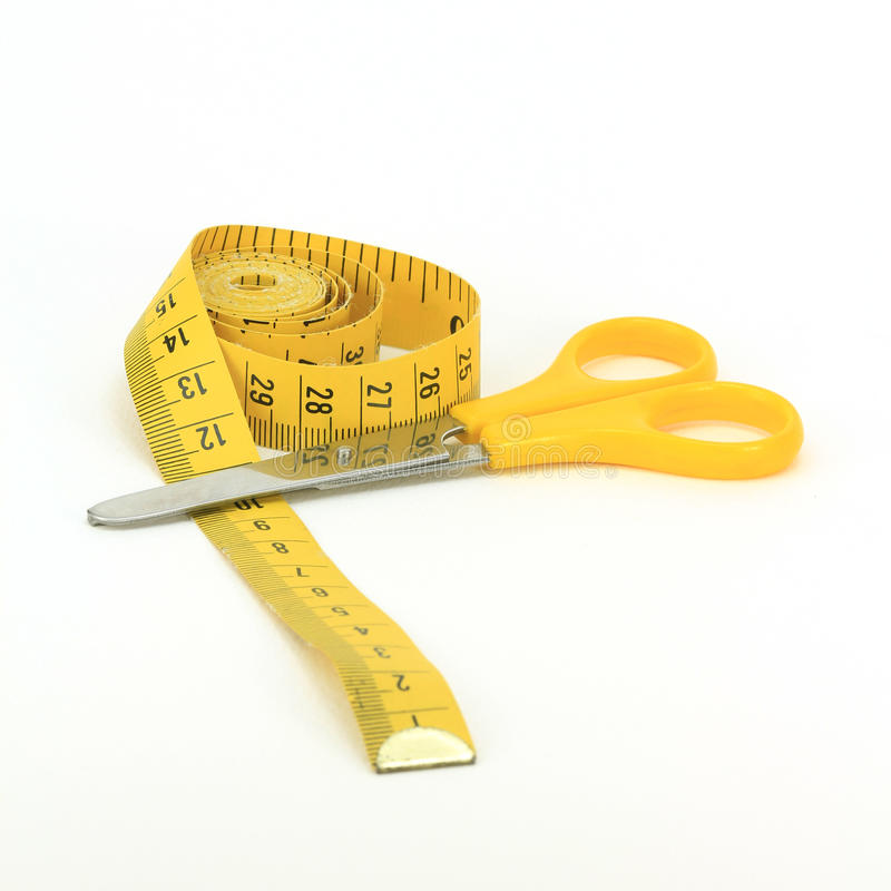 Scissors and tape measure royalty free stock image