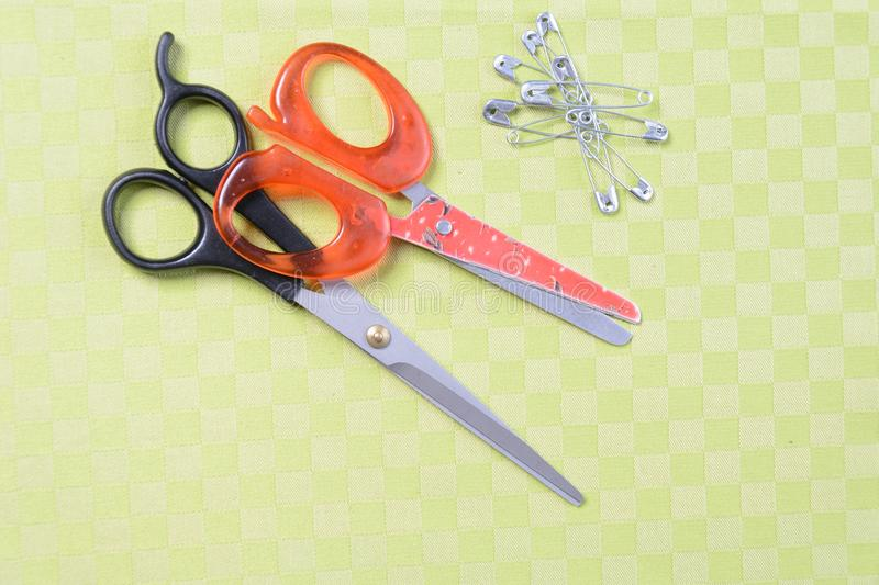 Scissors and threads on fabric, top view Tailoring equipment stock images
