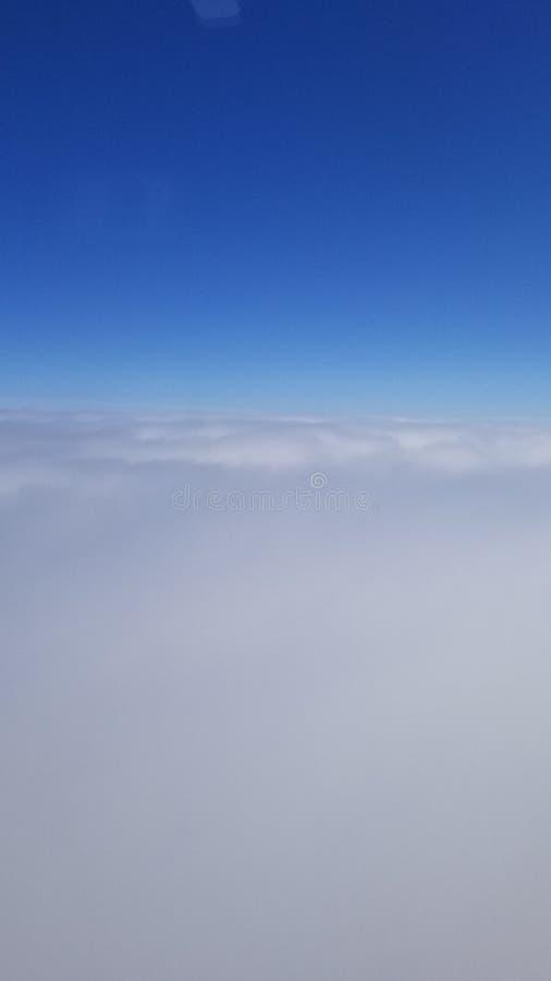 Scivolando sulle nuvole immagini stock