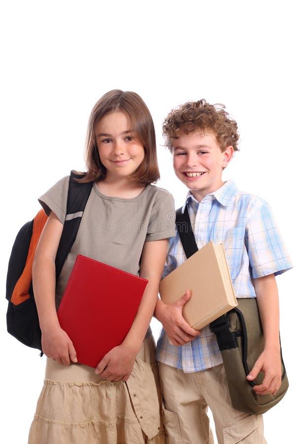 Scolara e scolaro immagine stock
