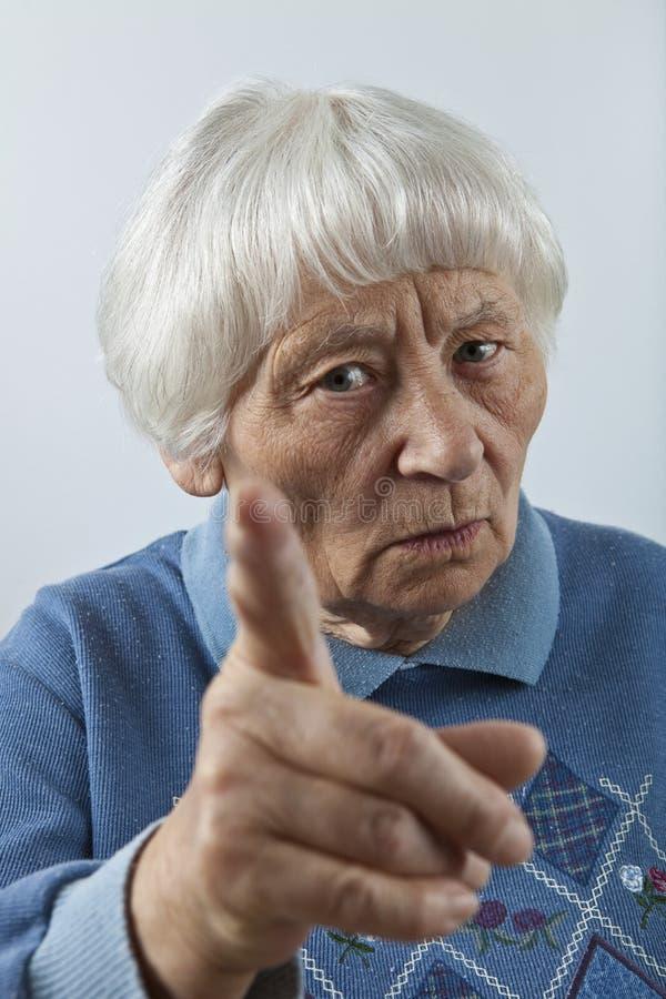 Scolding senior woman stock photo