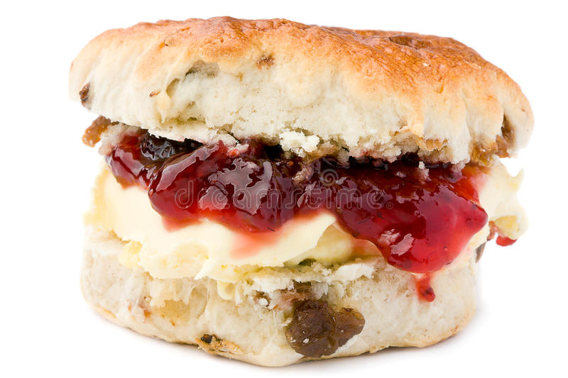Scone with jam and clotted cream. royalty free stock photos