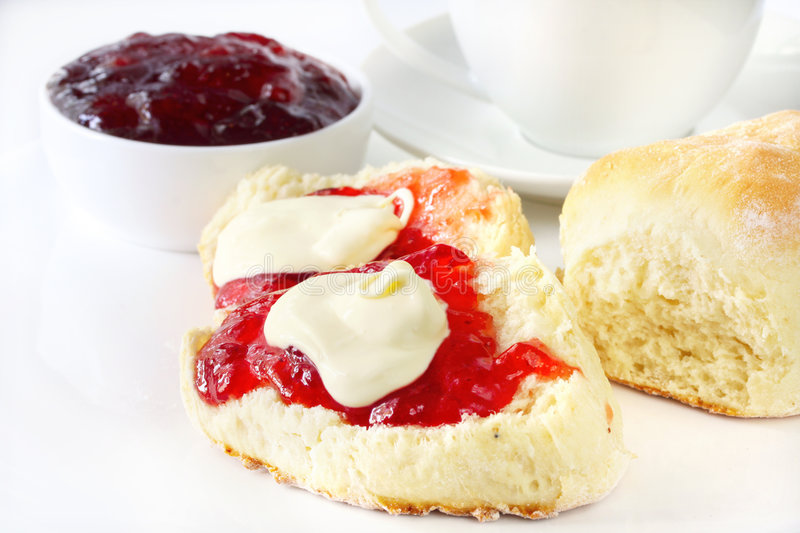 Scones with Jam and Cream. Devonshire Tea - Scones with strawberry jam and fresh cream stock photos