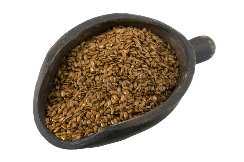 Scoop of brown flax seeds stock photo