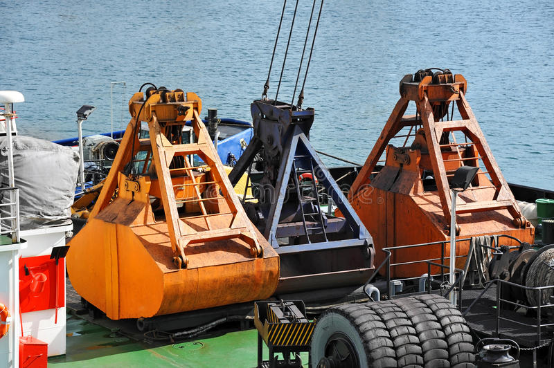 Scoop of cargo crane. On the ship deck stock image